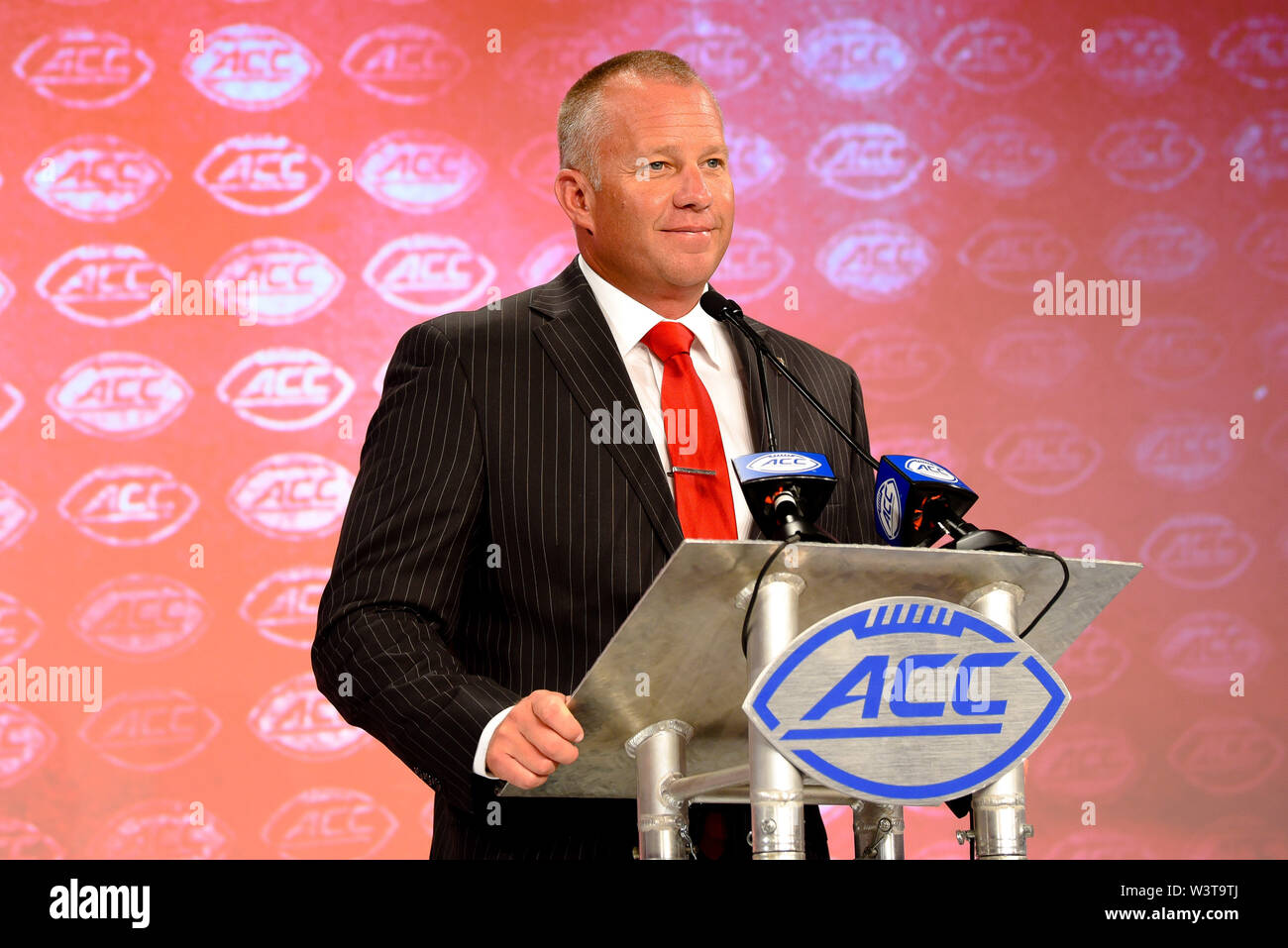 Charlotte, North Carolina, USA. 17th July, 2019. NC State Head Coach DAVE DOEREN speaking to reporters during the ACC Atlantic Division Coach/Student interviews on July 17, 2019 at the Westin Hotels & Resorts in Charlotte, N.C. Credit: Ed Clemente/ZUMA Wire/Alamy Live News - Stock Image