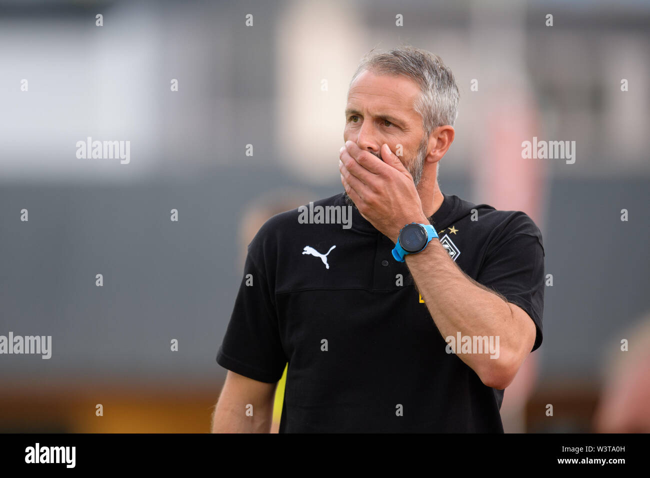Kufstein, Austria. 17th July, 2019. Soccer: Test matches, Borussia Mönchengladbach - Basaksehir FC in Kufstein. Coach Marco Rose von Mönchengladbach observes the game. Credit: Matthias Balk/dpa/Alamy Live News - Stock Image