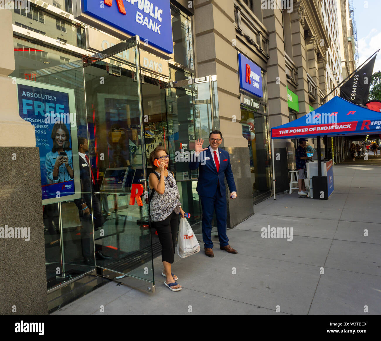 A branch of Republic Bank in Greenwich Village in New York on its grand opening day, Friday, July 12, 2019. The bank was started by Vernon Hill, former CEO of Commerce Bank which later was acquired by TD Bank. Color scheme, decor and logos and fonts are similar to graphics used by Commerce Bank. (© Richard B. Levine) - Stock Image