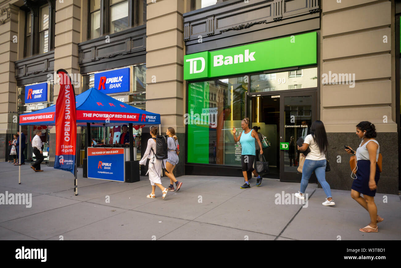A branch of Republic Bank, next to a TD Bank, in Greenwich Village in New York on its grand opening day, Friday, July 12, 2019. The Republic Bank was started by Vernon Hill, former CEO of Commerce Bank which later was acquired by TD Bank. Color scheme, decor and logos and fonts are similar to graphics used by Commerce Bank. (© Richard B. Levine) - Stock Image