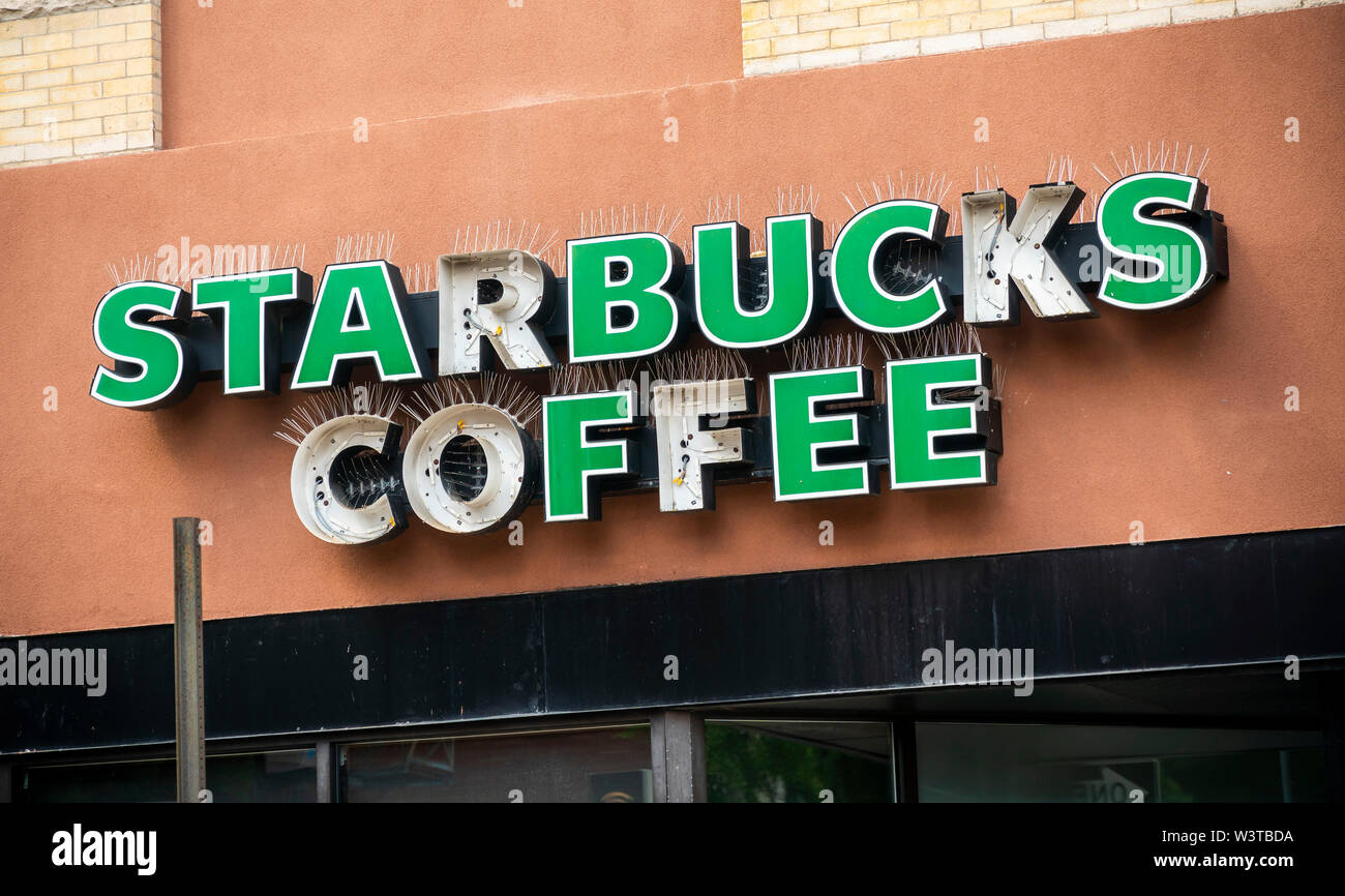 A distressed Starbucks coffee shop sign in Brooklyn in New York on Sunday, July 14, 2019. (© Richard B. Levine) - Stock Image