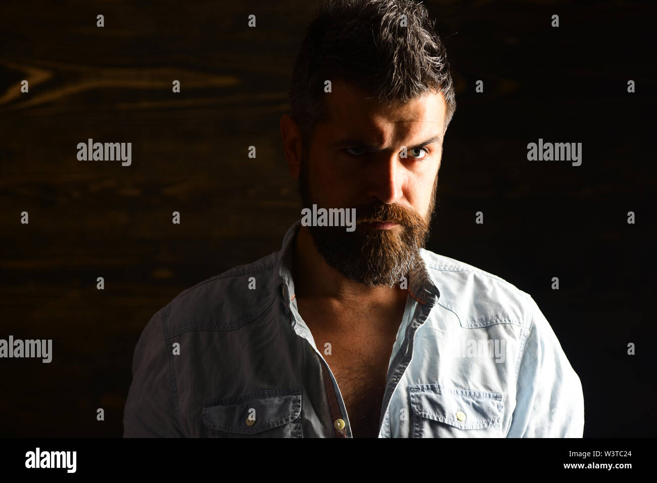Serious hipster in barbershop, look. Barber and hairdresser salon. Haircut of bearded man, archaism. Fashion and male beauty of graying man. Man with Stock Photo