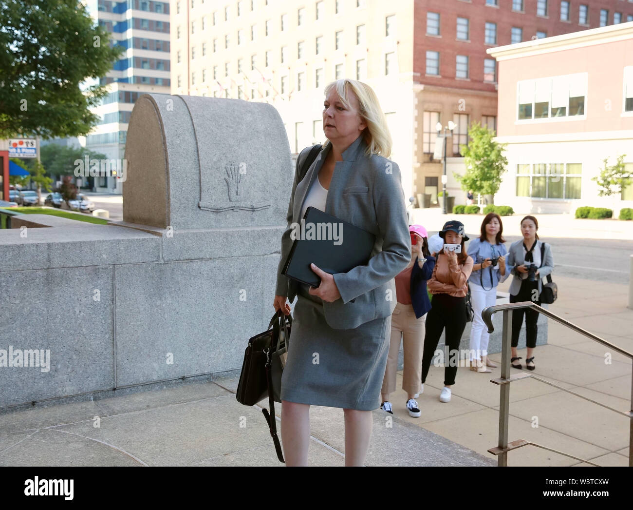 (190717) -- PEORIA (U.S.), July 17, 2019 (Xinhua) -- Julie Brain, defense attorney for Brendt Christensen, heads to the federal courthouse building in Peoria, Illinois, the United States, on July 17, 2019. After a U.S. judge concludes all the evidence from the sentencing phase in the Chinese scholar slaying trial Tuesday, closing arguments from both prosecutors and the defense started here Wednesday morning. The closing arguments of the sentencing phase for Brendt Christensen who was found guilty of killing Zhang Yingying in 2017 took place around 9 a.m.(1400 GMT) at a federal court of Peoria, - Stock Image