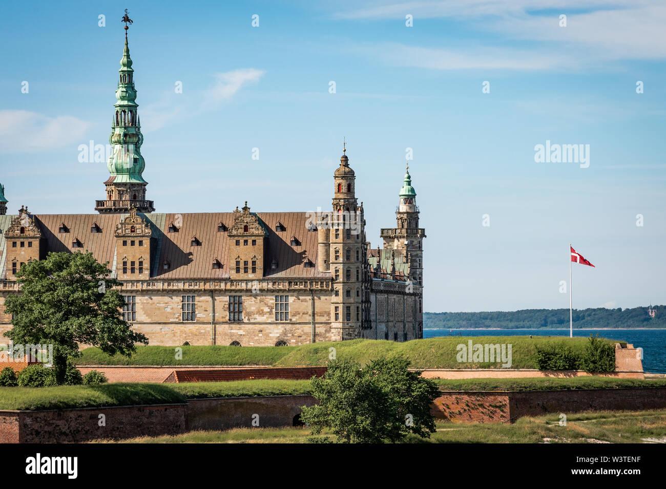 Kronborg Castle an the danish flag in Elsinore, Denmark, June 16, 2019 - Stock Image