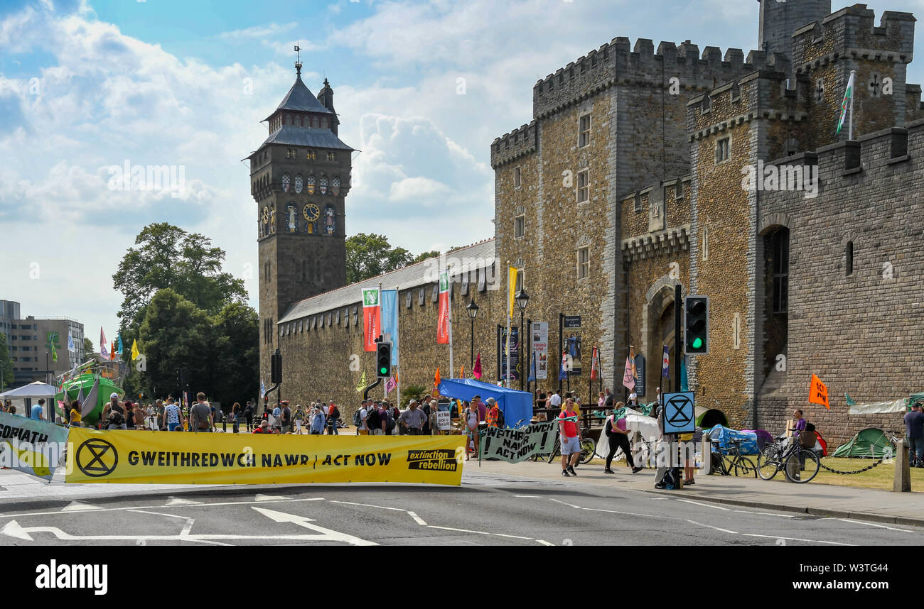 CARDIFF, WALES - JULY 2019: Large bilingual banner blocking a road in Cardiff during a Climate Emergency protest by Extinction Rebellion. Stock Photo