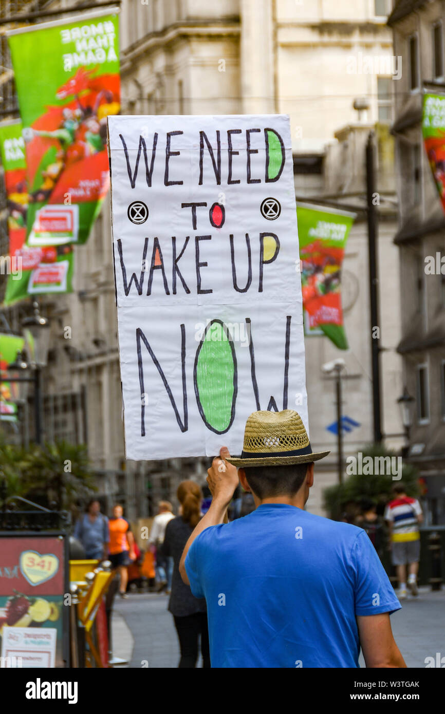 CARDIFF, WALES - JULY 2019: Person holding a notice with a message at the Climate Emergency protest by Extinction Rebellion in Cardiff city centre. Stock Photo