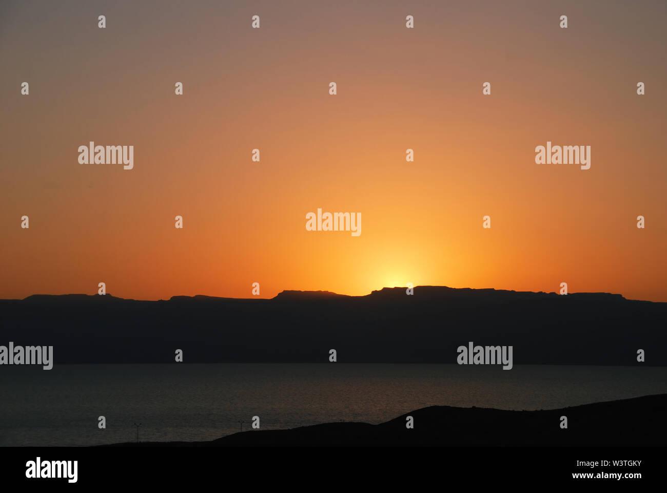 Sunset over the Gulf of Aqaba in Jordan - Stock Image