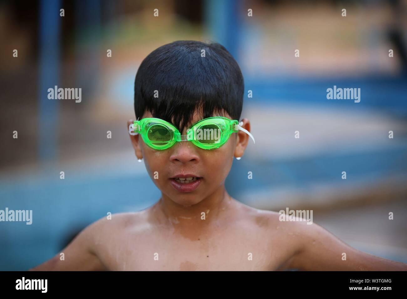 Gaza City, The Gaza Strip, Palestine. 17th July, 2019. A Palestinian boy play at a swimming pool on a hot day in the Gaza Strip. Credit: Hassan Jedi/Quds Net News/ZUMA Wire/Alamy Live News - Stock Image