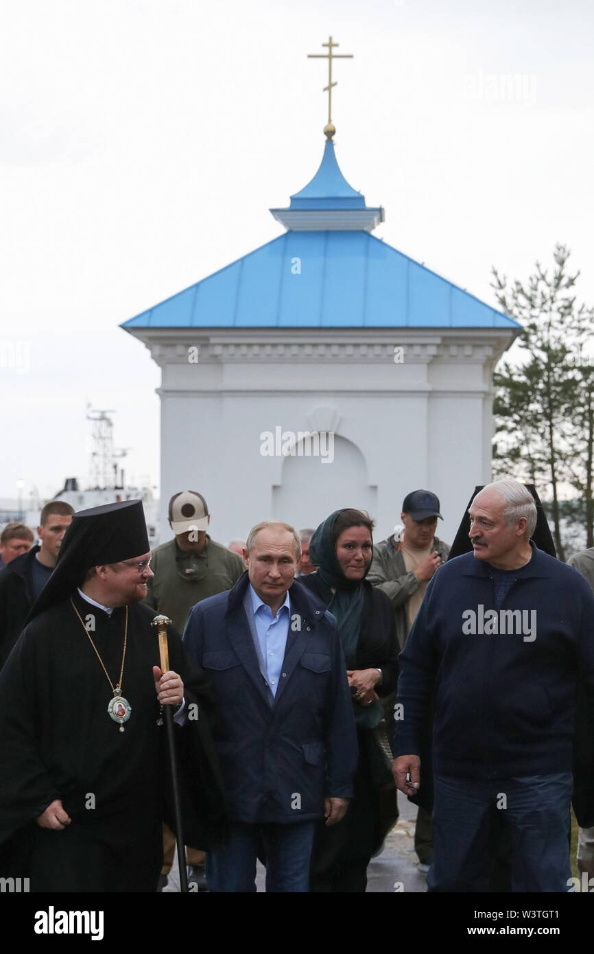 Russia. 17th July, 2019. LENINGRAD REGION, RUSSIA - JULY 17, 2019: Bishop Ignatius of Vyborg and Priozersk welcomes Russia's President Vladimir Putin, Belarus' President Alexander Lukashenko (L-R front) on their visit to the Konevsky Monastery on Lake Ladoga. Mikhail Klimentyev/Russian Presidential Press and Information Office/TASS Credit: ITAR-TASS News Agency/Alamy Live News - Stock Image