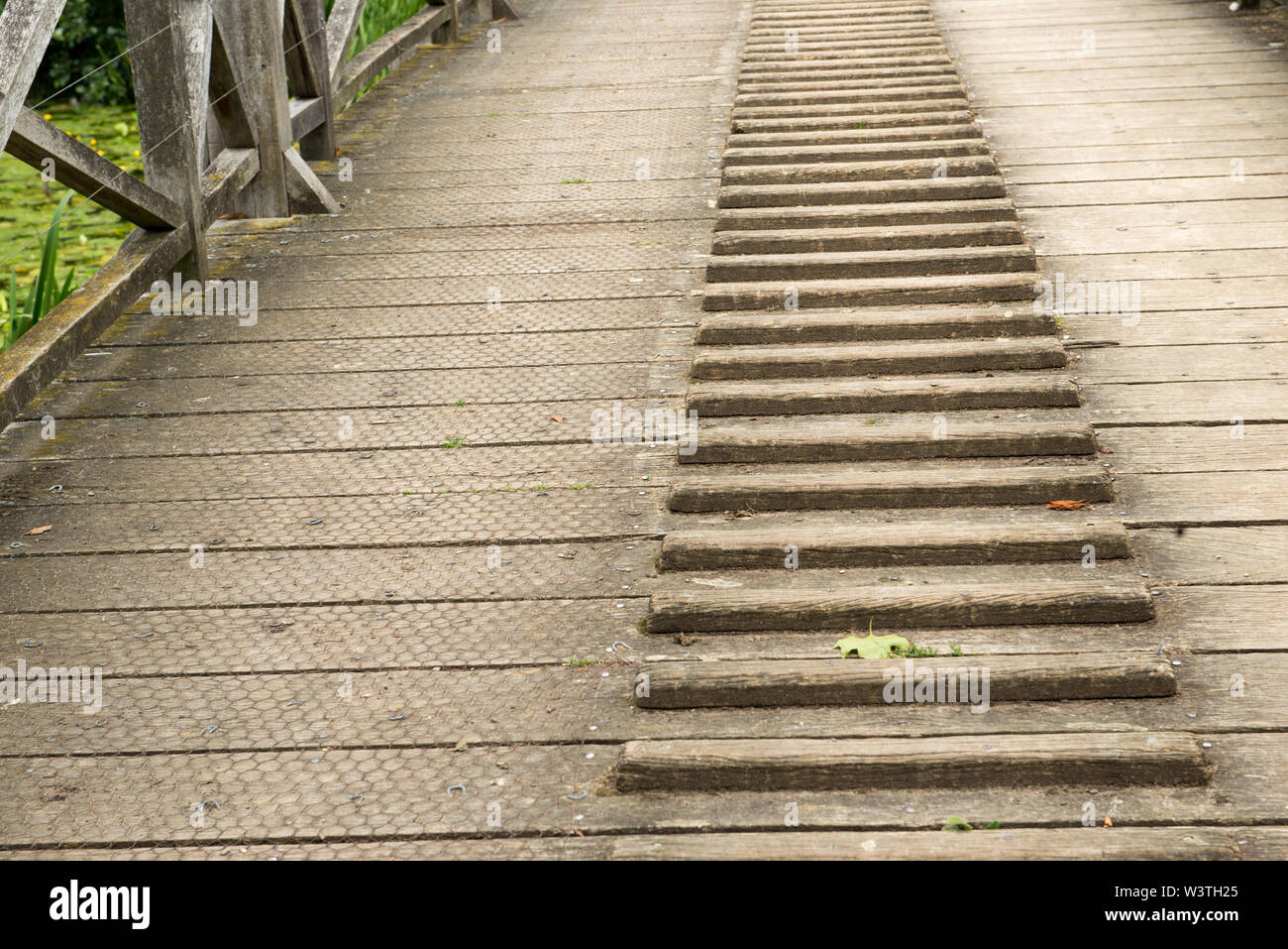 close up of weathered wooden bridge with foot tread for using when pulling objects - Stock Image