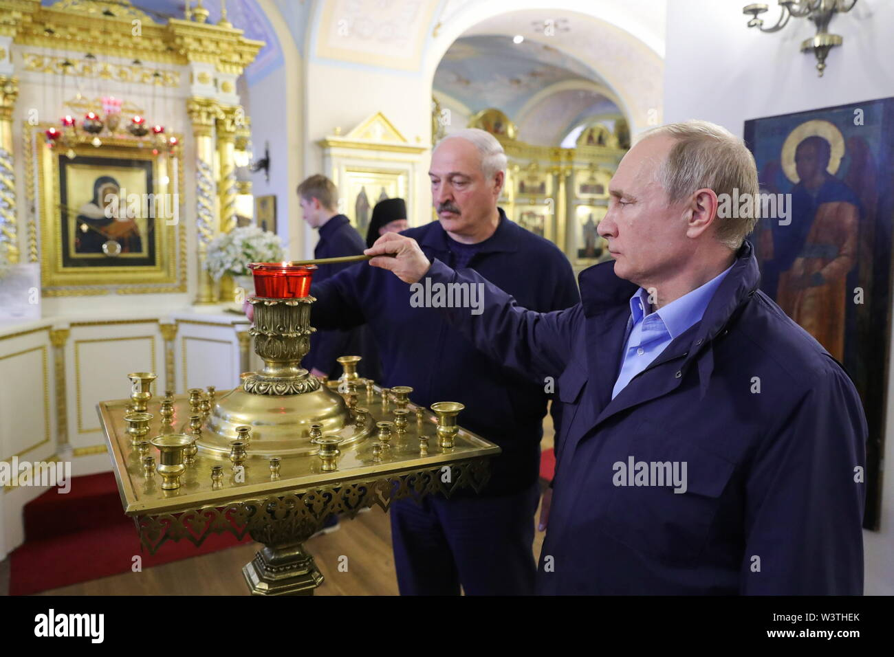 Russia. 17th July, 2019. LENINGRAD REGION, RUSSIA - JULY 17, 2019: Russia's President Vladimir Putin (R) and Belarus' President Alexander Lukashenko light candles on their visit to the Konevsky Monastery on Lake Ladoga. Mikhail Klimentyev/Russian Presidential Press and Information Office/TASS Credit: ITAR-TASS News Agency/Alamy Live News - Stock Image