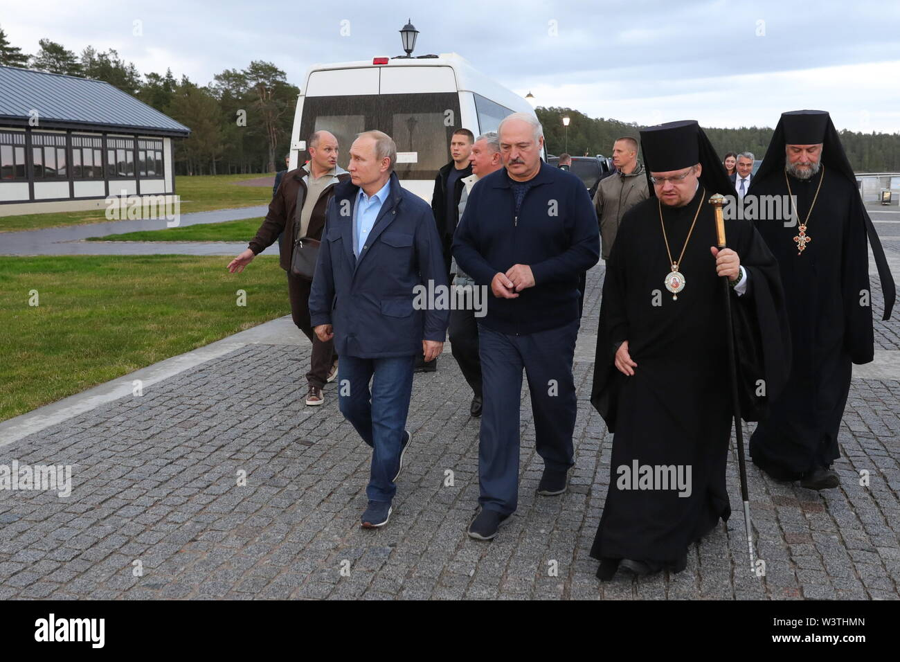 Russia. 17th July, 2019. LENINGRAD REGION, RUSSIA - JULY 17, 2019: Russia's President Vladimir Putin, Belarus' President Alexander Lukashenko, Bishop Ignatius of Vyborg and Priozersk, and father superior Alexander (L-R front) visit the Konevsky Monastery on Lake Ladoga. Mikhail Klimentyev/Russian Presidential Press and Information Office/TASS Credit: ITAR-TASS News Agency/Alamy Live News - Stock Image