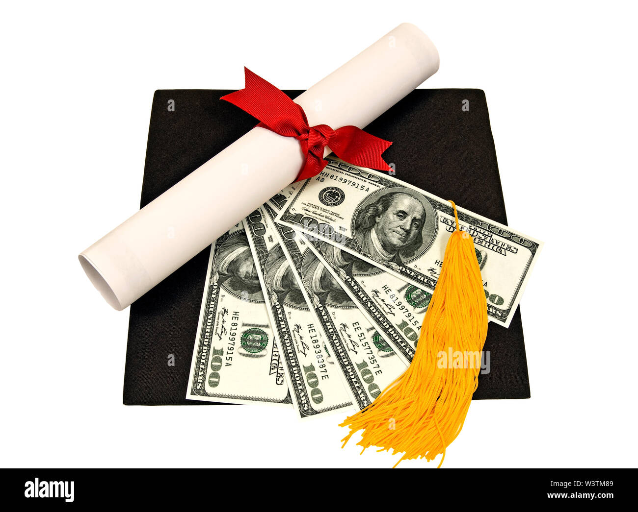 Horizontal shot of a flattened black mortarboard with a diploma tied with a red ribbon, a yellow tassel, and five one hundred dollar bills fanned out - Stock Image