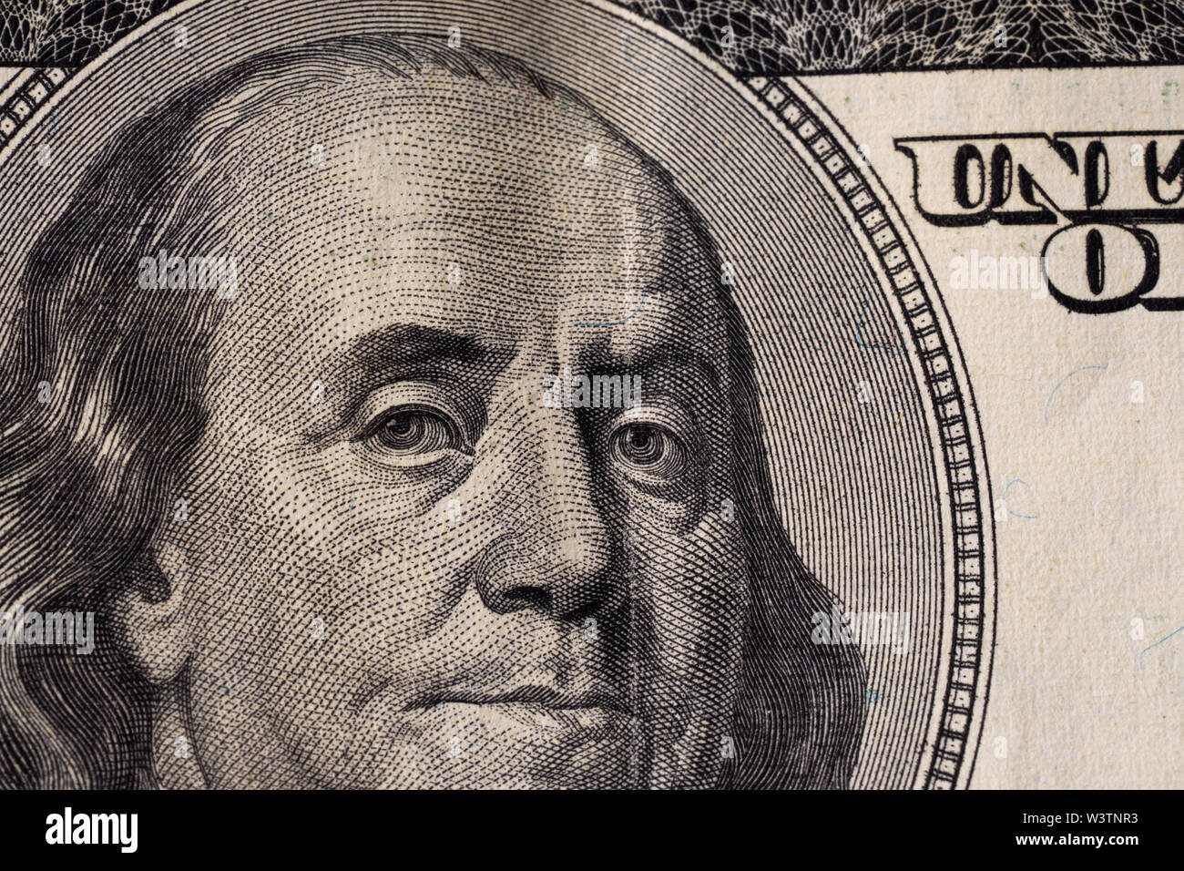A fragment of a bill of 100 US dollars.Portrait of Benjamin Franklin - Stock Image