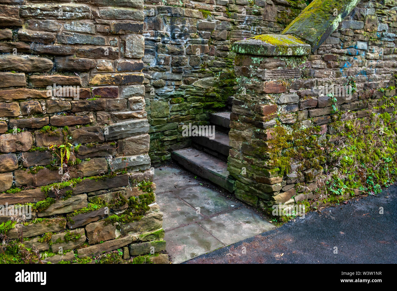 Landscape-format view of a staircase in an alcove in a sandstone wall Stock Photo
