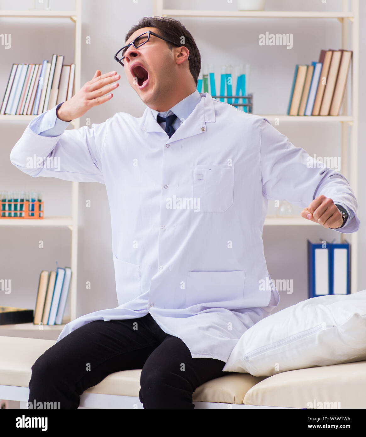 The doctor relaxing after complex surgery in hospital - Stock Image