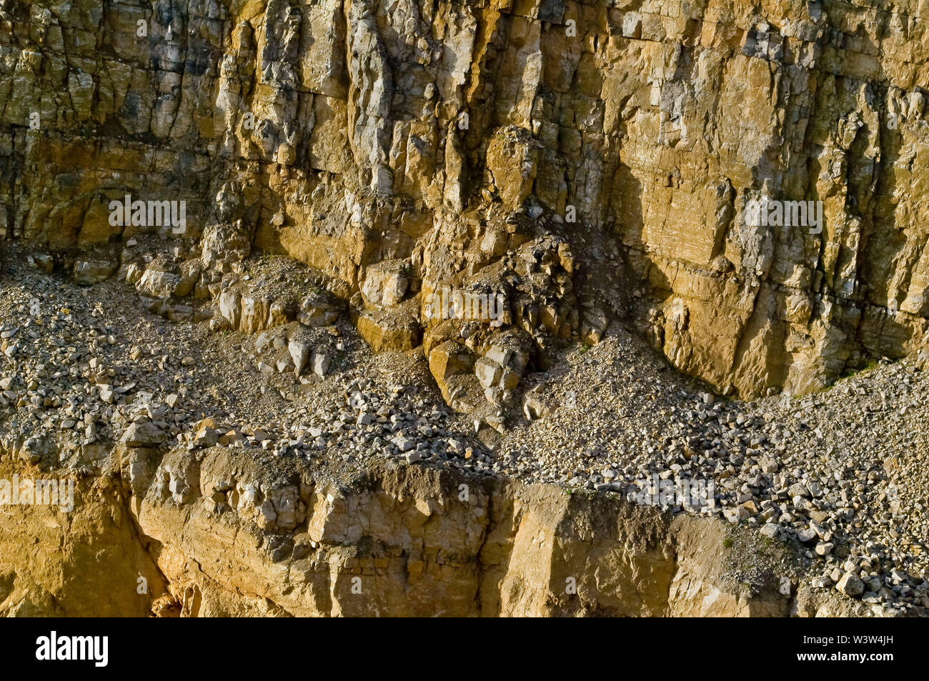 Quarry workings for Fluorite in the Peak District in bright sunshine showing the working faces Stock Photo