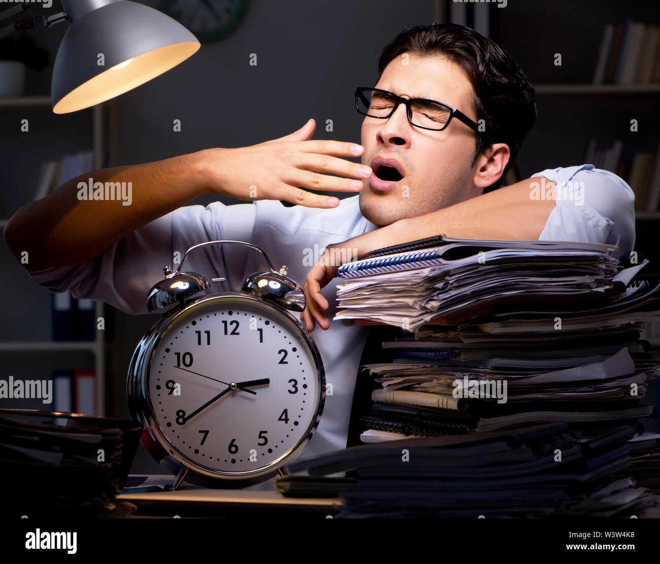 The young businessman working overtime late in office - Stock Image
