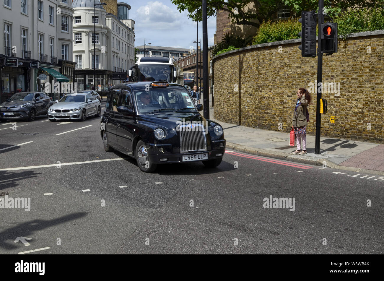London, United Kingdom, June 2018. London taxis, called cabs, are one of the symbols of the city. Classically of strictly black color. Sometimes with Stock Photo