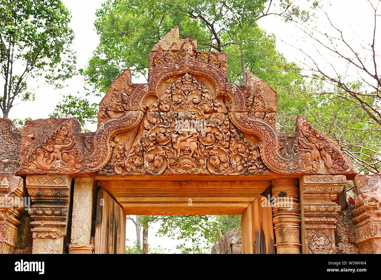 Banteay Srei Siem Reap Castle  is one of the most beautiful castles in Cambodia. Construction of pink sandstone Carved into patterns related to Hindui - Stock Image