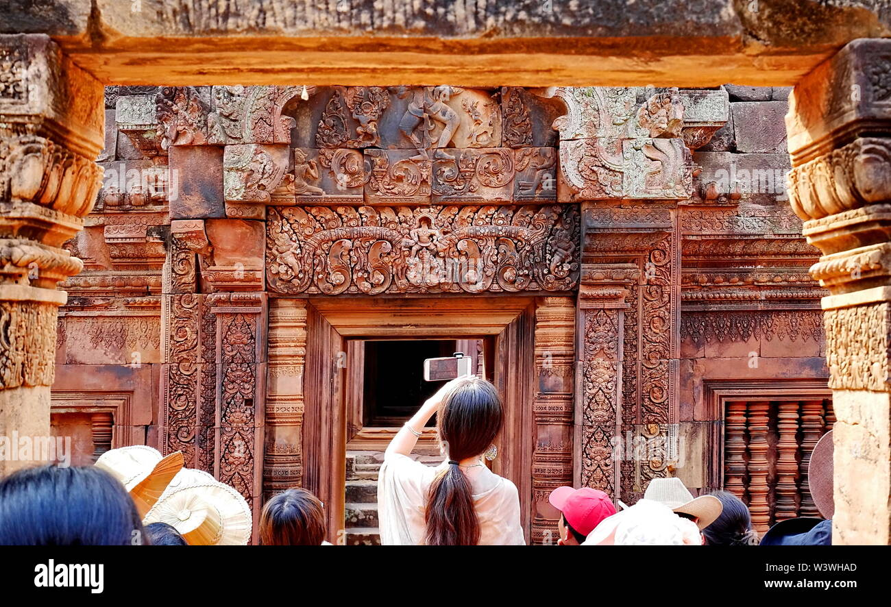 tourist are visiting Banteay Srei Siem Reap Castle is one of the most  beautiful castles in Cambodia Construction of pink sandstone Carved into patter - Stock Image