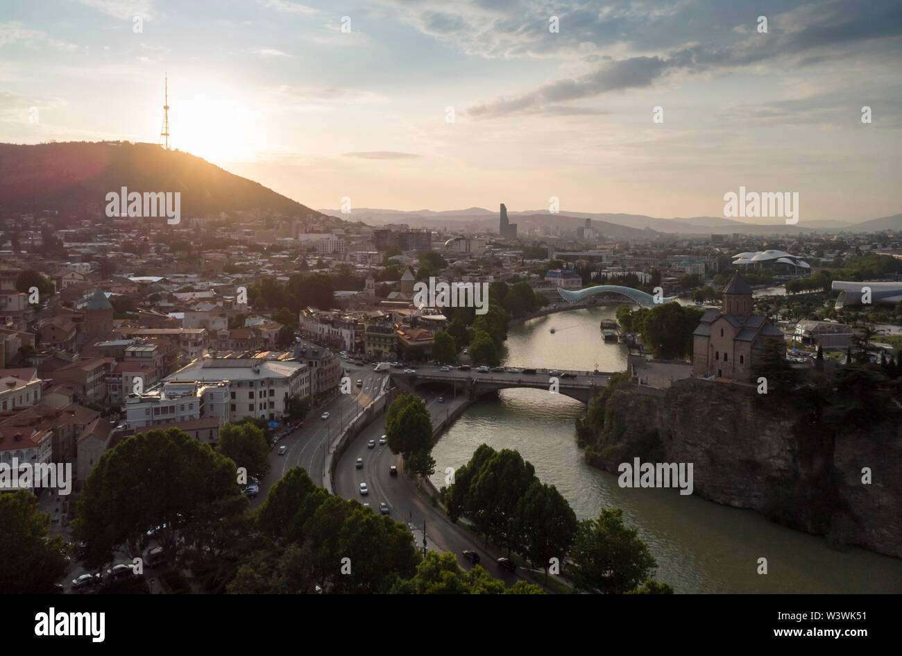 Aerial Cityscape of Tbilisi, Georgia, sunset and cityscape of Tbilisi, Georgia, view on the mountains on backround. - Stock Image