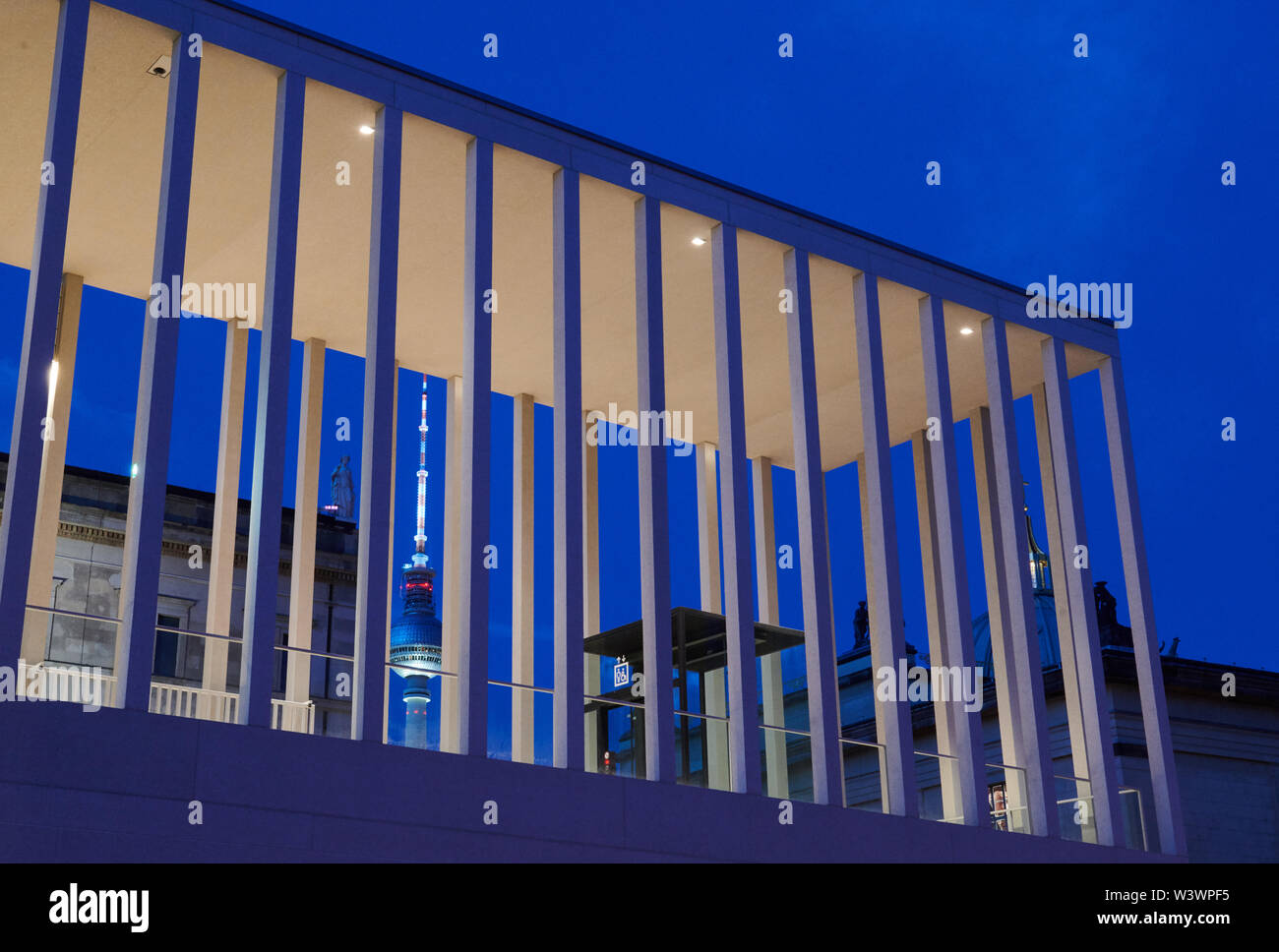 Berlin, Germany. 17th July, 2019. By stealing the recently opened James Simon Gallery on Museum Island you can see the television tower at the blue hour. Credit: Annette Riedl/dpa/Alamy Live News Stock Photo