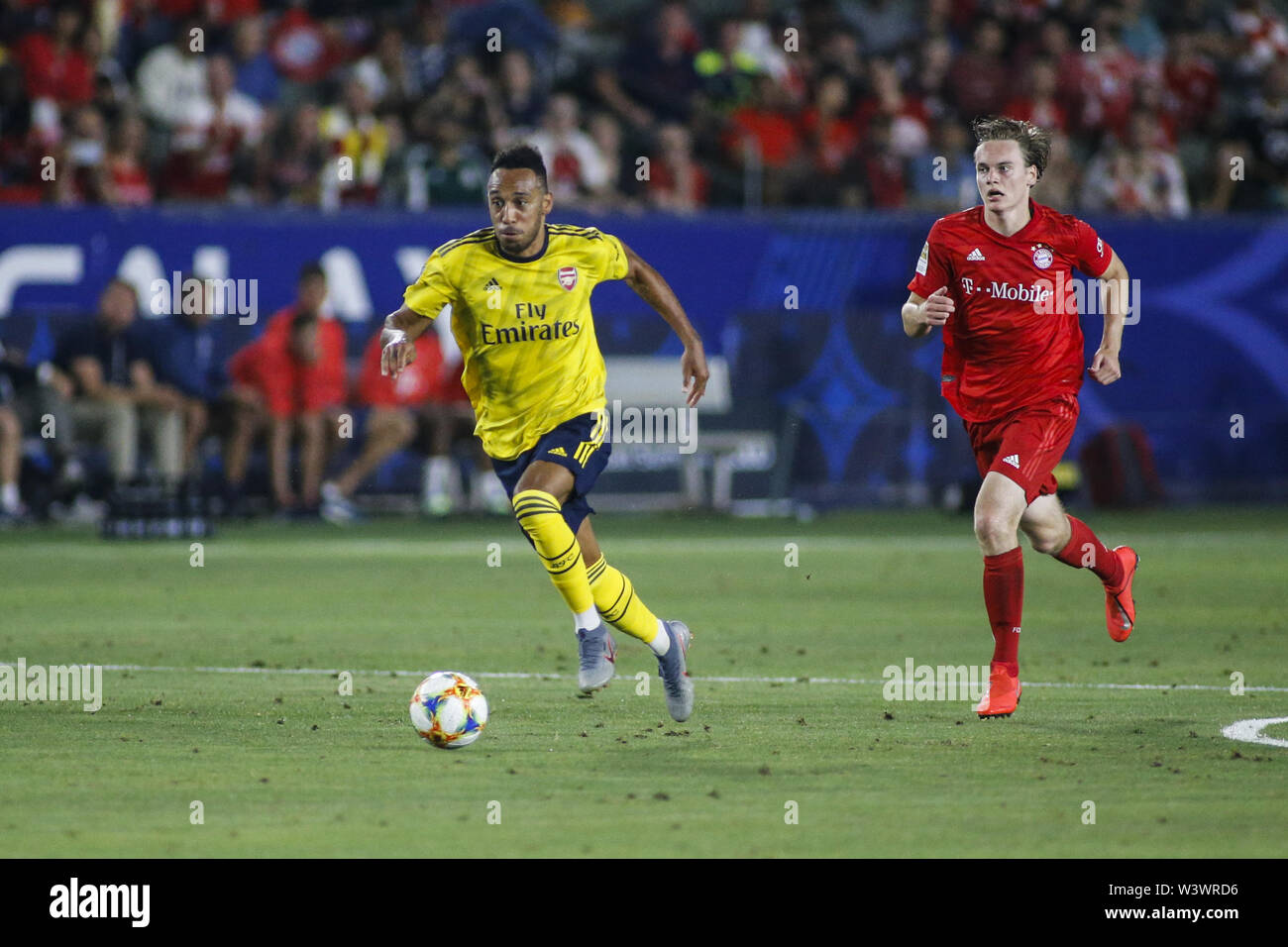 Los Angeles, California, USA. 17th July, 2019. Arsenal forward Pierre-Emerick Aubameyang (14) drives the ball past Bayern Munich forward Ryan Johansson (45) during the 2019 International Champions Cup (ICC) match between Arsenal and Bayern Munich in Carson, California, July 17, 2019. Arsenal won 2-1. Credit: Ringo Chiu/ZUMA Wire/Alamy Live News - Stock Image