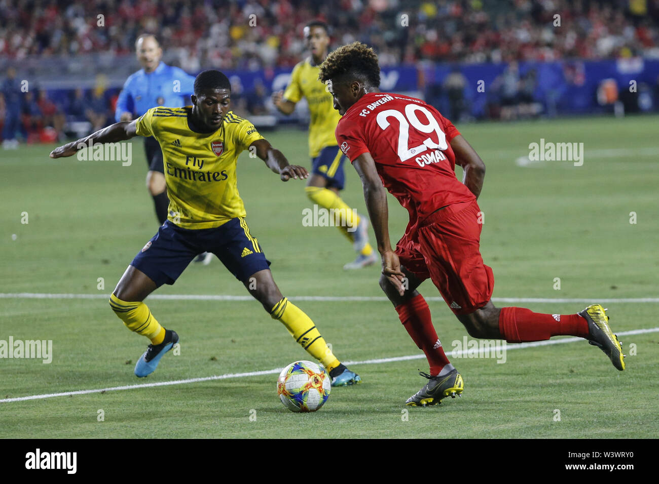 Los Angeles, California, USA. 17th July, 2019. Bayern Munich midfielder Kingsley Coman (29) drives the ball against Arsenal midfielder Ainsley Maitland-Niles (15) during the 2019 International Champions Cup (ICC) match between Arsenal and Bayern Munich in Carson, California, July 17, 2019. Arsenal won 2-1. Credit: Ringo Chiu/ZUMA Wire/Alamy Live News - Stock Image