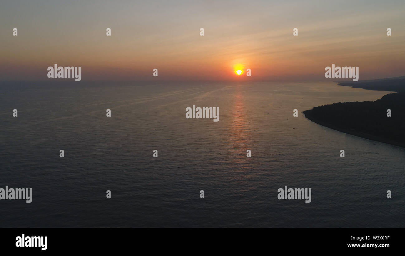 aerial view sunrise over ocean. seascape colorful sunrise over sea at tropical resort - Stock Image