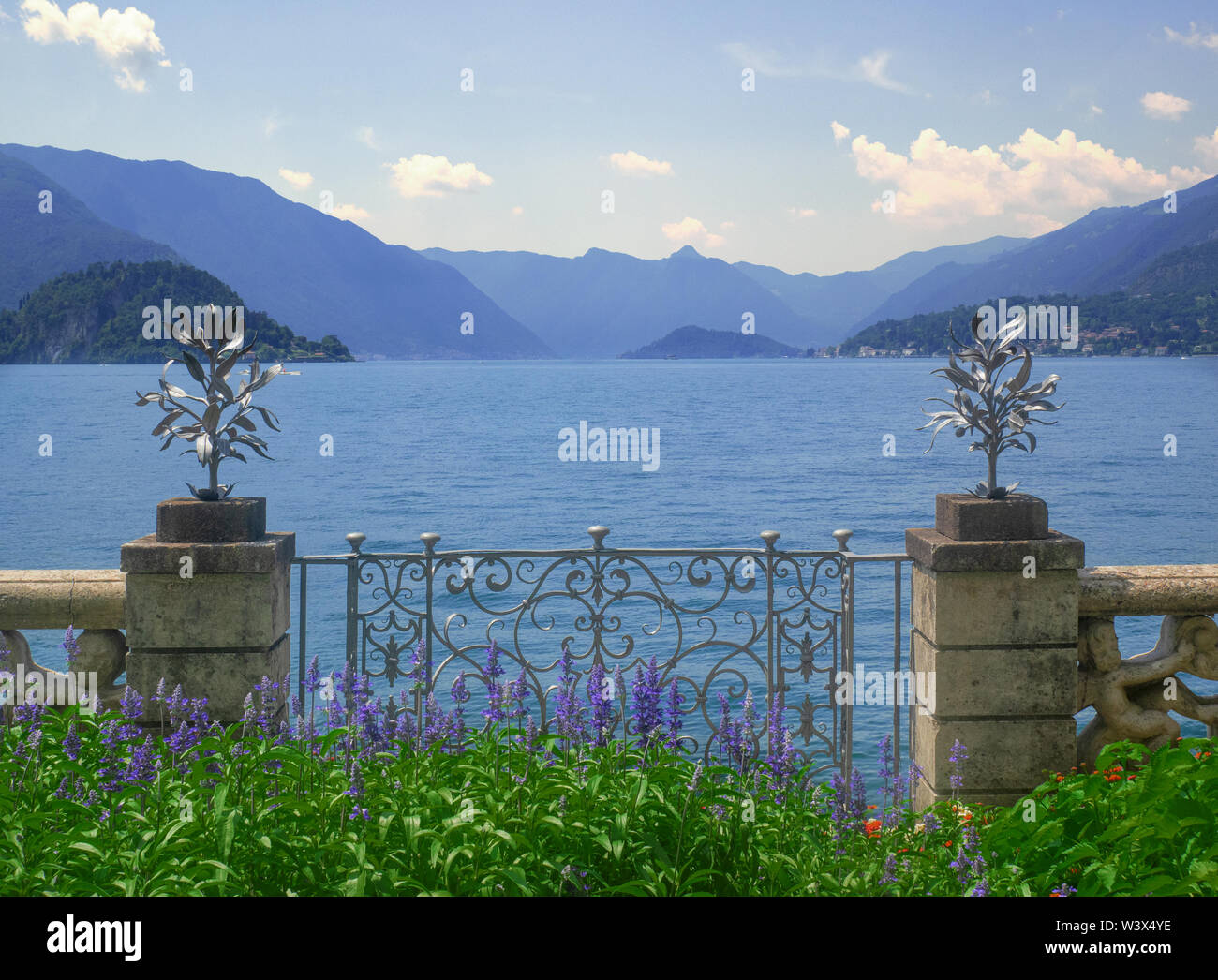 panoramic point of the Como Lake from a small balcony surrounded by flowers.Lombardy - Italy - Stock Image