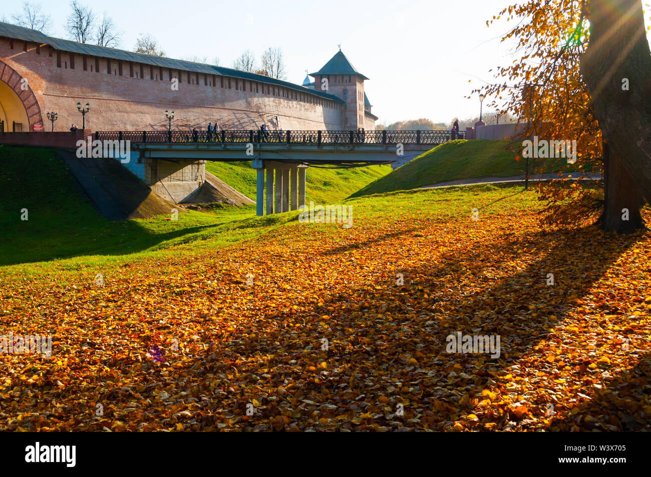 Veliky Novgorod, Russia. Towers of Veliky Novgorod Kremlin fortress in sunny autumn day. Focus at the fortress - Stock Image