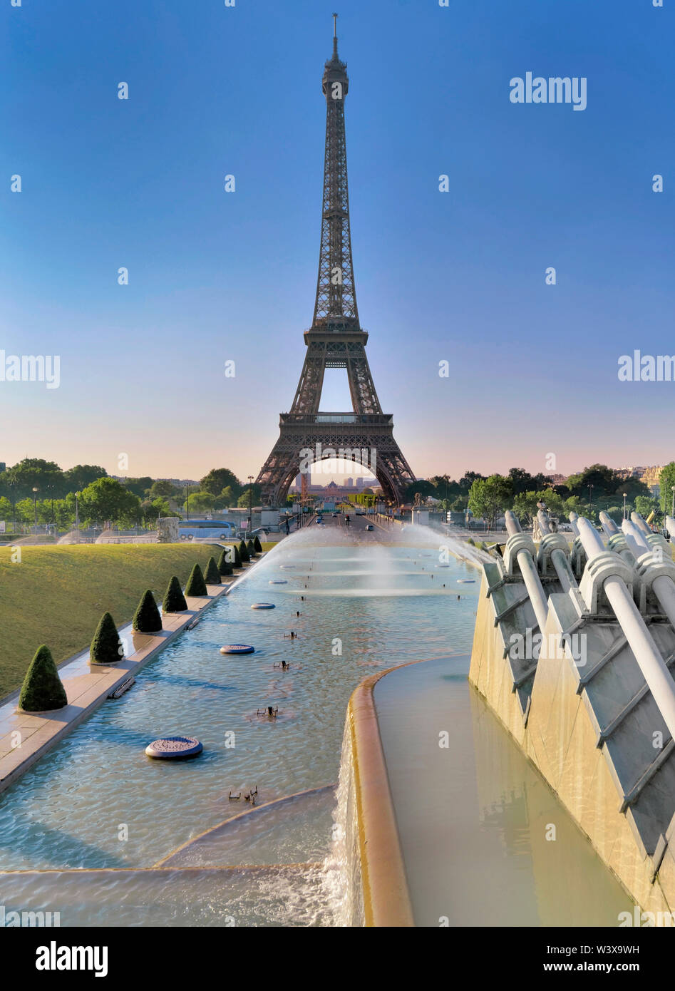 view on Eiffel Tower in Paris from pond of trocadero  in morning - Stock Image