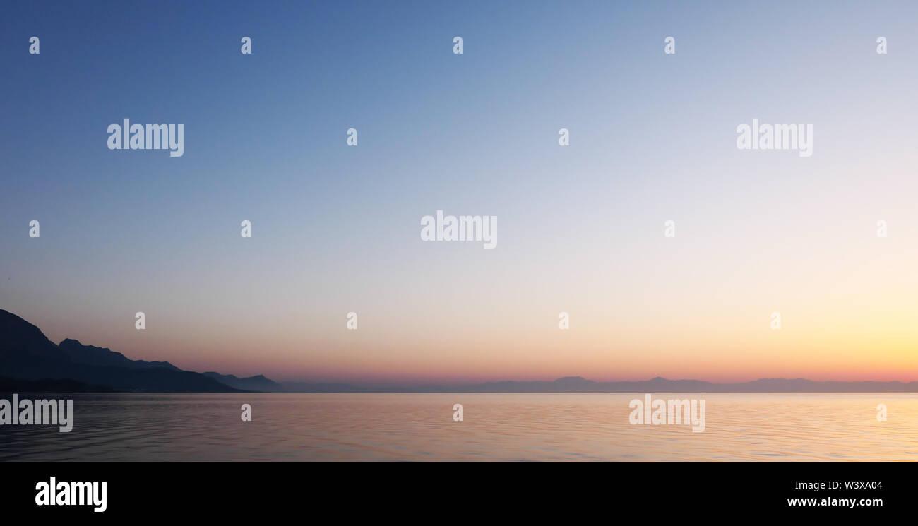 Beautiful sunrise over sea, morning seascape - Stock Image