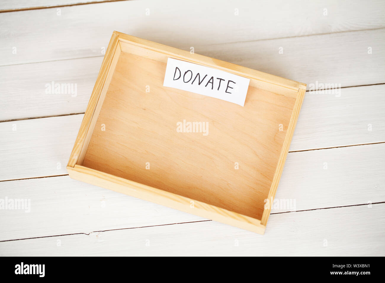 Donations and Charity. Donation Concept. A Donation Box on the White Background. Inscription Donate - Stock Image