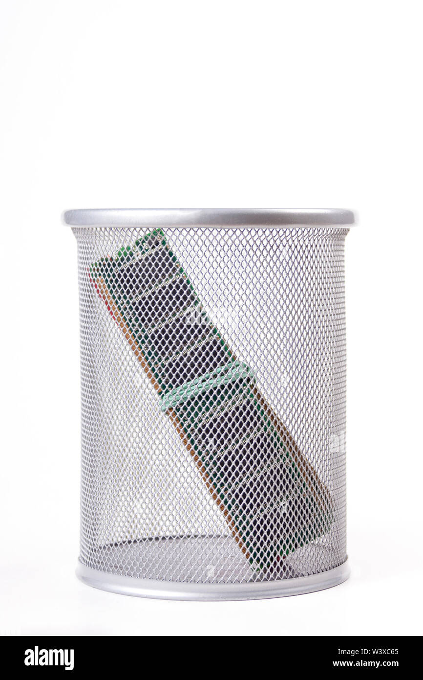 A stick of RAM in a metal trash can. Old memory sticks, wasting random access memory concept, unused or outdated PC components being thrown away, time - Stock Image