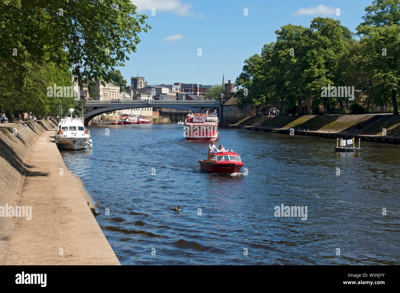 Tourists on boats on the River Ouse in summer York North Yorkshire England UK United Kingdom GB Great Britain Stock Photo