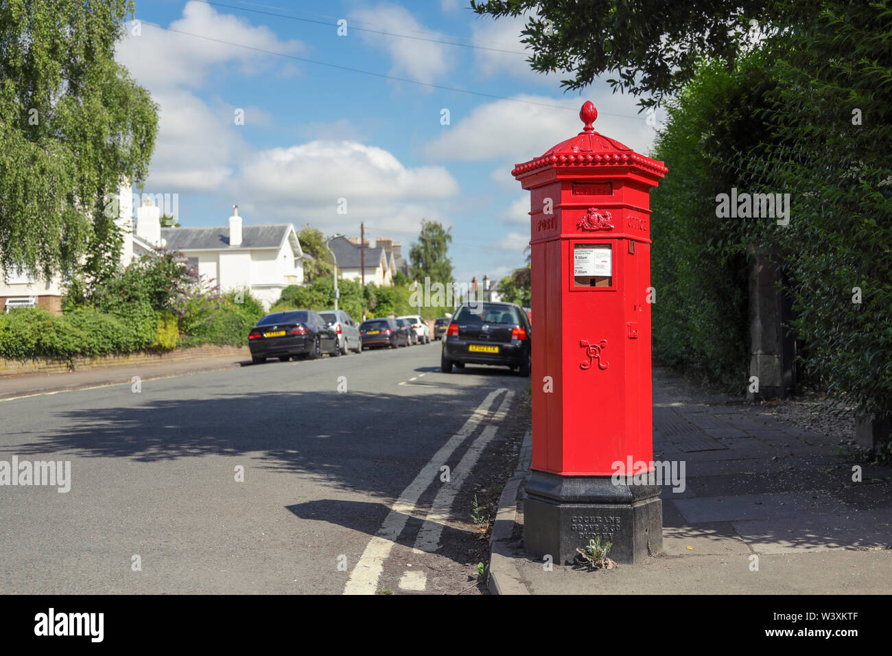 One of Cheltenham's rare original hexagonal shaped Royal Mail Penfold post boxes Stock Photo