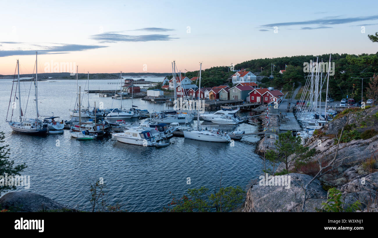 Resö, Sweden - July 16, 2017: View into the sailing and fishing harbour of Resö during sunset, western Sweden. - Stock Image
