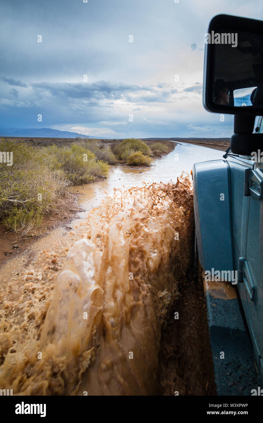 After a rare hard rain, the roads in Tankwa Karoo National Park become flooded, navigable only by four-wheel drive, Northern Cape, South Africa. Stock Photo