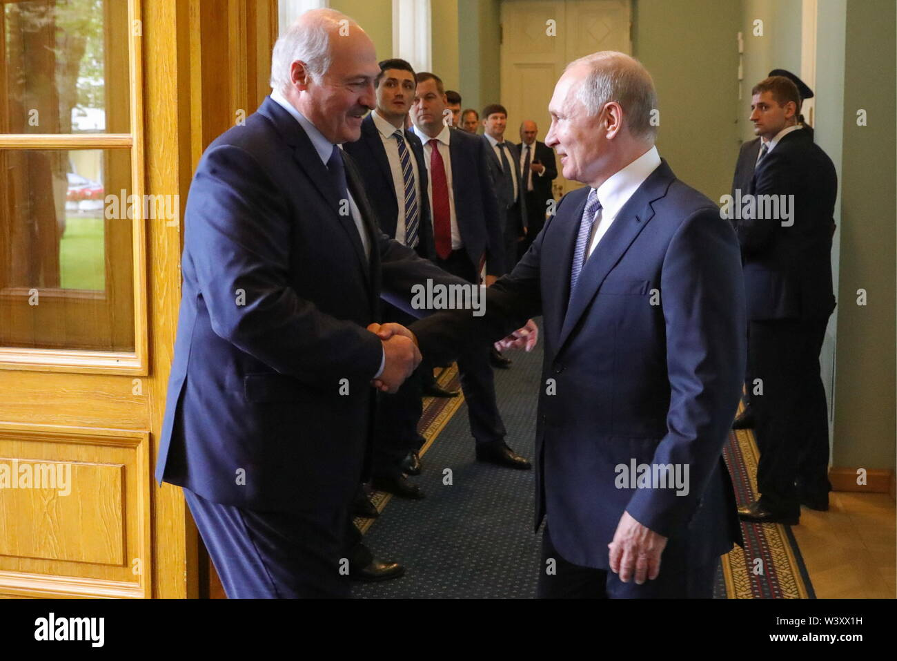 St Petersburg, Russia. 18th July, 2019. ST PETERSBURG, RUSSIA - JULY 18, 2019: Belarus' President Alexander Lukashenko (L) and Russia's President Vladimir Putin shake hands during a meeting at Tauride Palace. Mikhail Klimentyev/Russian Presidential Press and Information Office/TASS Credit: ITAR-TASS News Agency/Alamy Live News - Stock Image