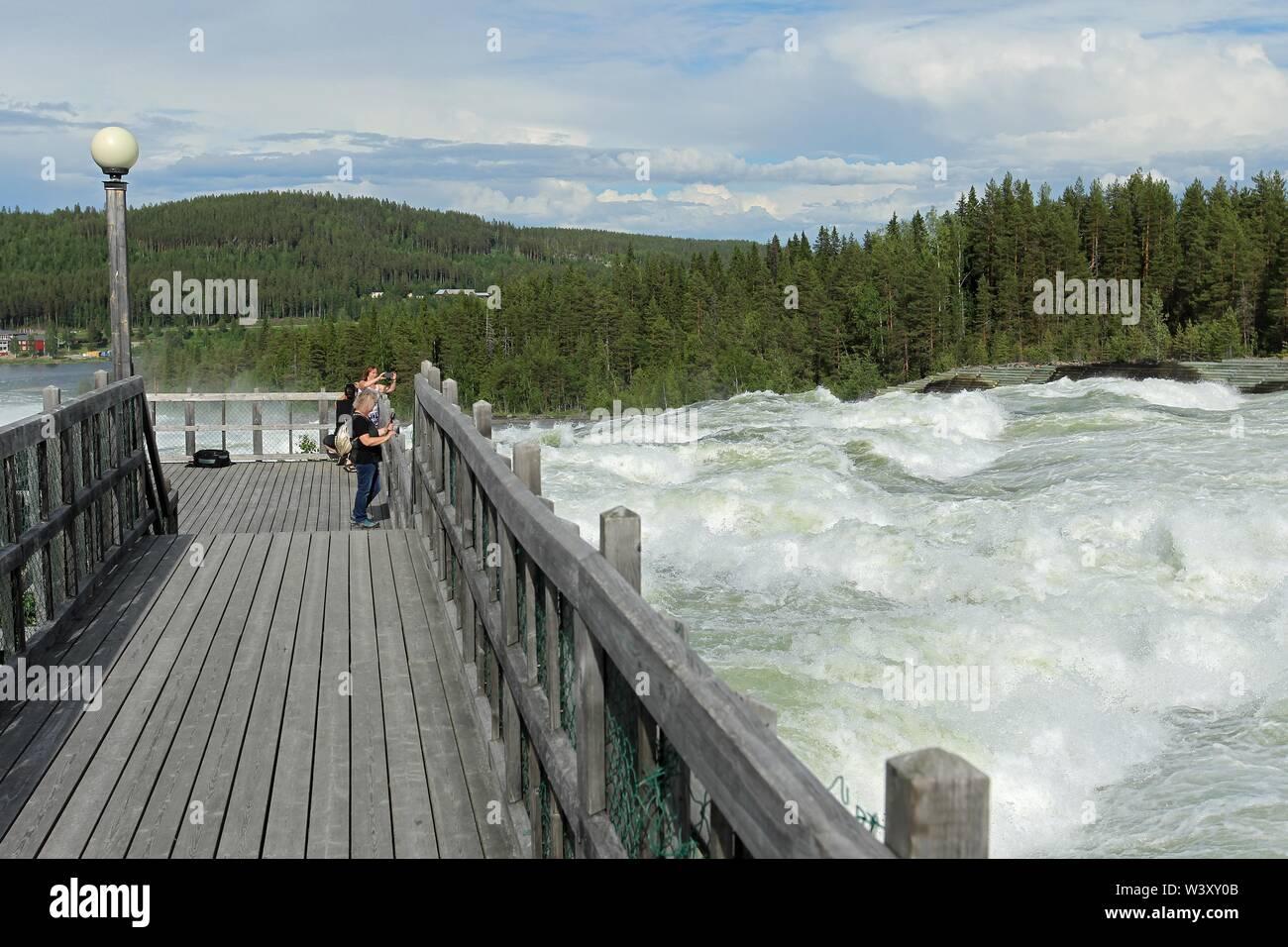 Tourists at the rapids Storforsen in the river Pitealven, Vidsel, Lapland, Sweden - Stock Image