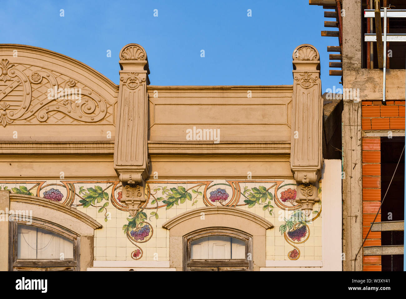 frieze in tiles of azulejos.  fruit and flower pattern on a beautiful patrician building In Olhao, Algarve, Portugal - Stock Image