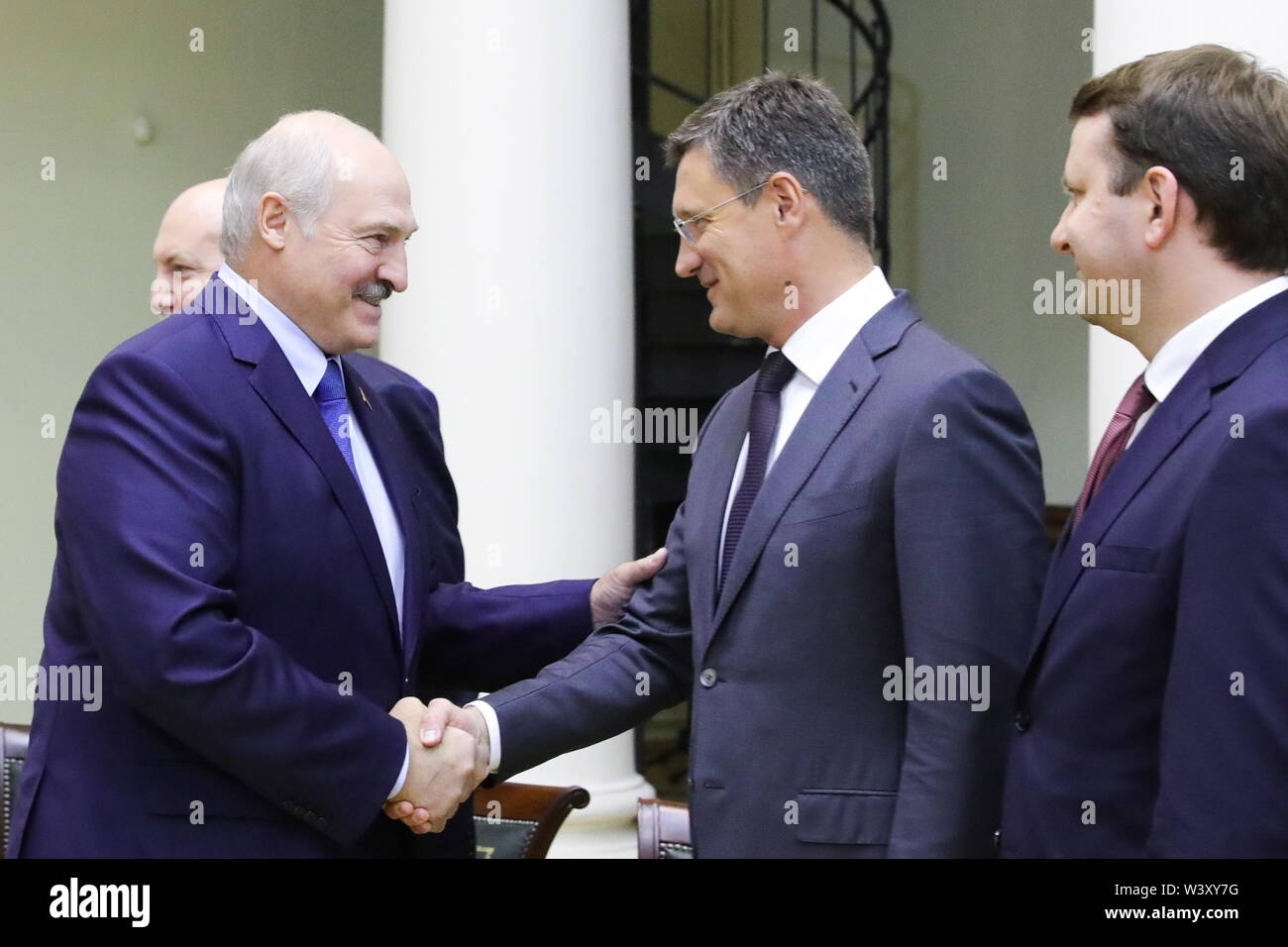 St Petersburg, Russia. 18th July, 2019. ST PETERSBURG, RUSSIA - JULY 18, 2019: Belarus' President Alexander Lukashenko and Russia's Energy Minister Alexander Novak shake hands as Russia's Economic Development Minister Maxim Oreshkin (L-R) looks on during a meeting with Russia's President Vladimir Putin during a meeting at Tauride Palace. Mikhail Klimentyev/Russian Presidential Press and Information Office/TASS Credit: ITAR-TASS News Agency/Alamy Live News - Stock Image