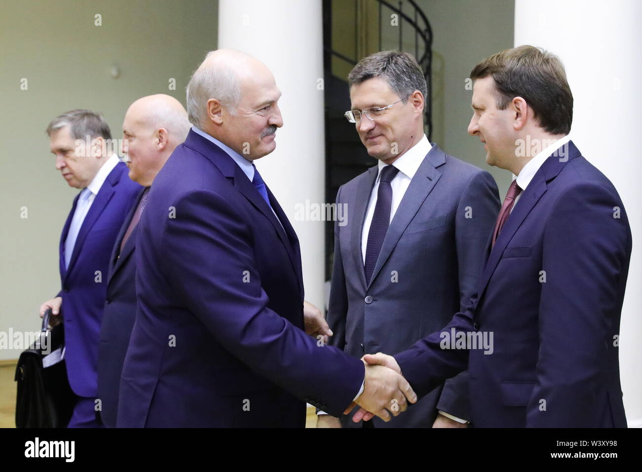 St Petersburg, Russia. 18th July, 2019. ST PETERSBURG, RUSSIA - JULY 18, 2019: Belarus' President Alexander Lukashenko and Russia's Economic Development Minister Maxim Oreshkin (L-R front) shake hands as Russia's Energy Minister Alexander Novak (C) looks on during a meeting with Russia's President Vladimir Putin during a meeting at Tauride Palace. Mikhail Klimentyev/Russian Presidential Press and Information Office/TASS Credit: ITAR-TASS News Agency/Alamy Live News - Stock Image