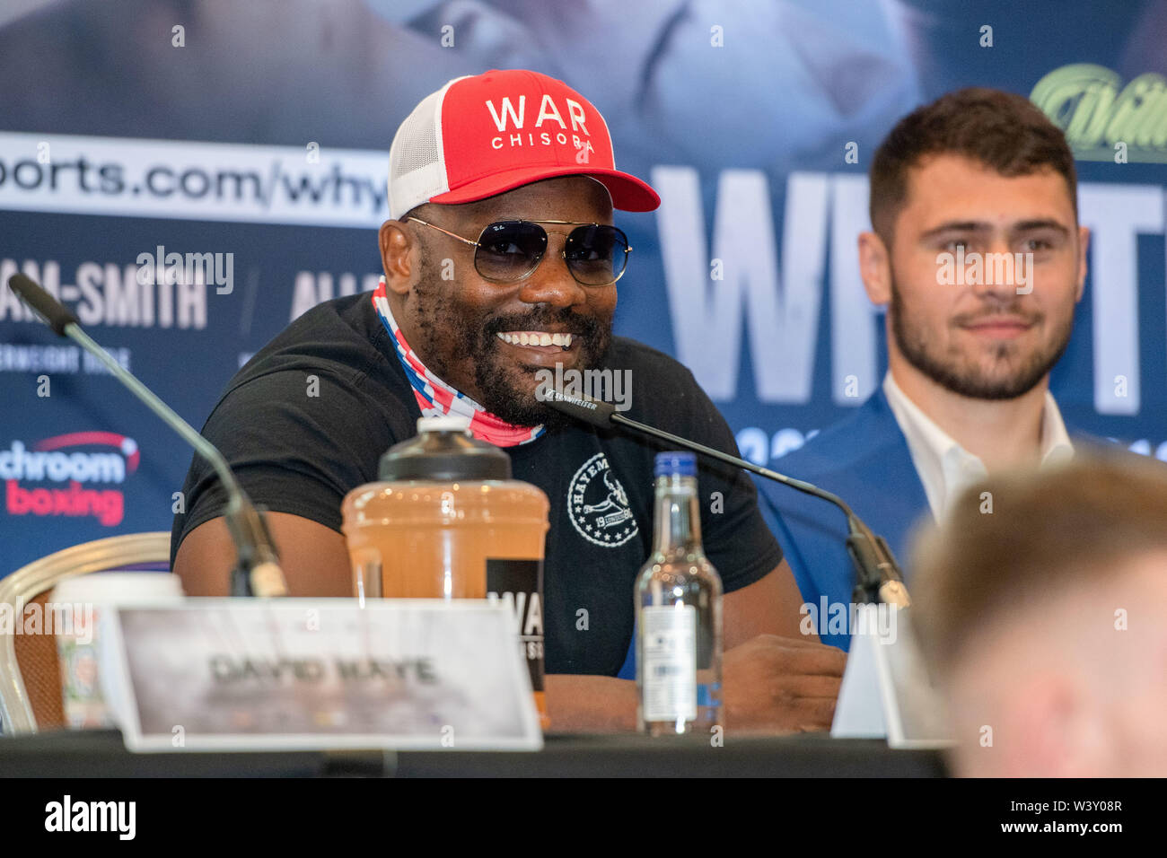 LONDON, UNITED KINGDOM. 18th Jul, 2019. Derek Chisora aka Derek War (left) and Dave Allen (right) during Matchroomboxing presents Dillian Whyte vs Oscar Rivas Press Conference at Canary Riverside Plaza Hotel on Thursday, July 18, 2019 in LONDON, ENGLAND.  (Editorial use only, license required for commercial use. No use in betting, games or a single club/league/player publications.) Credit: Taka G Wu/Alamy Live News Stock Photo