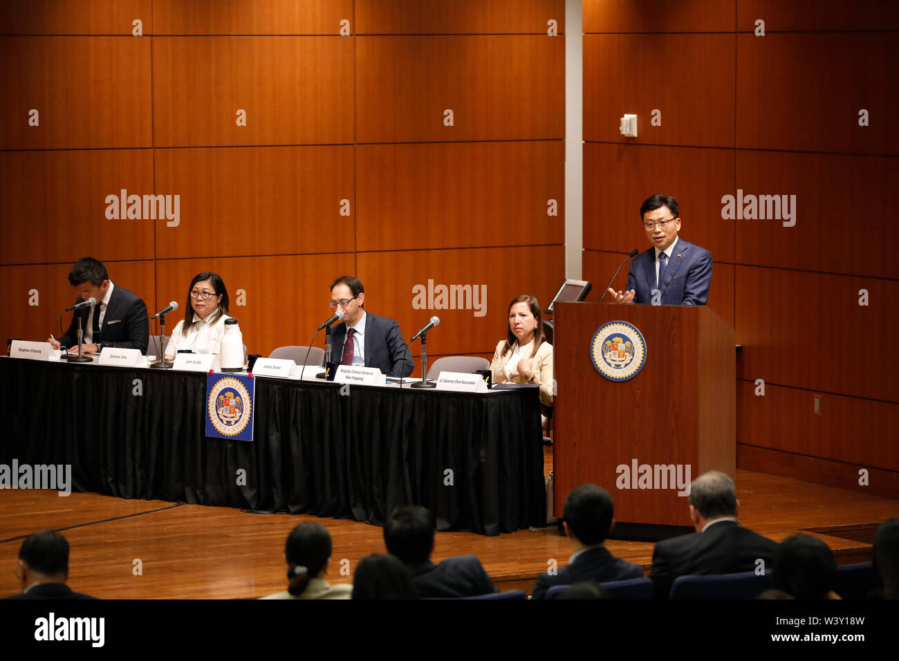 (190718) -- SAN FRANCISCO, July 18, 2019 (Xinhua) -- Chinese Deputy Consul General Ren Faqiang (1st R) speaks at a hearing on the effects of U.S.-China trade dispute in San Francisco, California, the United States, July 17, 2019. California's agriculture was 'the hardest hit' in the ongoing U.S.-China trade dispute, with the biggest drop in exports to China recorded, a state assembly leader said Wednesday. American wine exports to China have fallen by 25 percent, with 90 percent of the loss coming from California, since U.S. President Donald Trump escalated trade frictions with China by imp - Stock Image