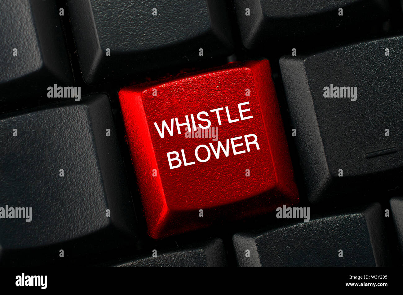 Whistleblowing concept: Black keyboard with a red key and the whistleblower word - Stock Image