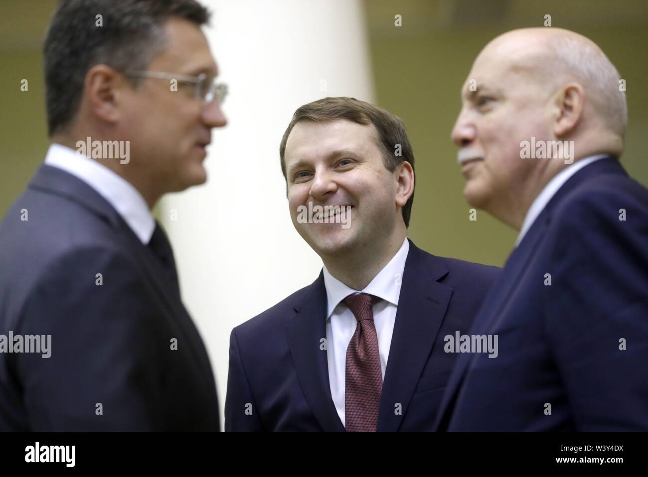 St Petersburg, Russia. 18th July, 2019. ST PETERSBURG, RUSSIA - JULY 18, 2019: Russia's Energy Minister Alexander Novak, Russia's Economic Development Minister Maxim Oreshkin and Russian Ambassador to Belarus Dmitry Mezentsev (L-R) during a meeting with Russian President Vladimir Putin at Tauride Palace. Mikhail Metzel/TASS Credit: ITAR-TASS News Agency/Alamy Live News - Stock Image