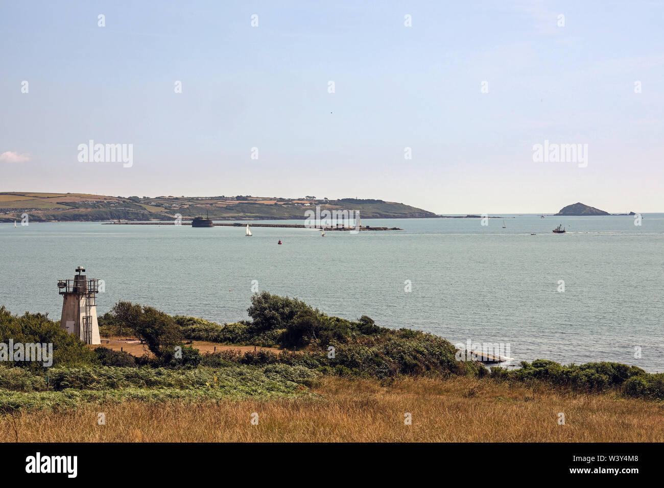 The Breakwater, Plymouth Sound and the Mewstone as seen from the path when approaching from Mount Edgcumbe Park Stock Photo